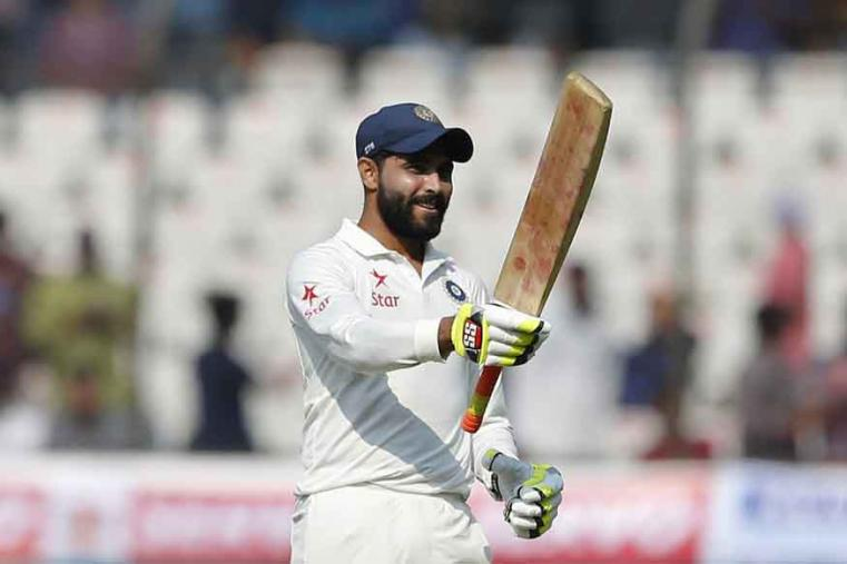 India's Ravindra Jadeja raises his bat to celebrate scoring fifty runs during the second day of a cricket test match against Bangladesh in Hyderabad. (AP Photo)