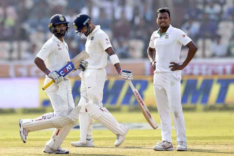 Bangladesh's Kamrul Islam Rabbi, right, reacts after India's Ajinkya Rahane, left, hit a boundary on his delivery during the first day of the test cricket match in Hyderabad. (AP Photo)