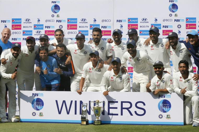 Members of Indian team pose with the winning trophy after their win over Bangladesh in their one-off cricket test match in Hyderabad. (AP Photo)