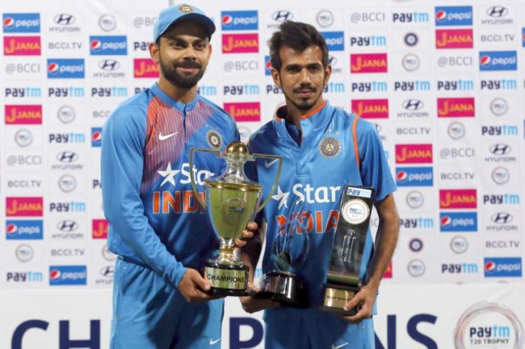 Team India captain Virat Kohli and Yuzvendra Chahal pose with the winners and Man of the Series trophies after win over England. (AP Photo)