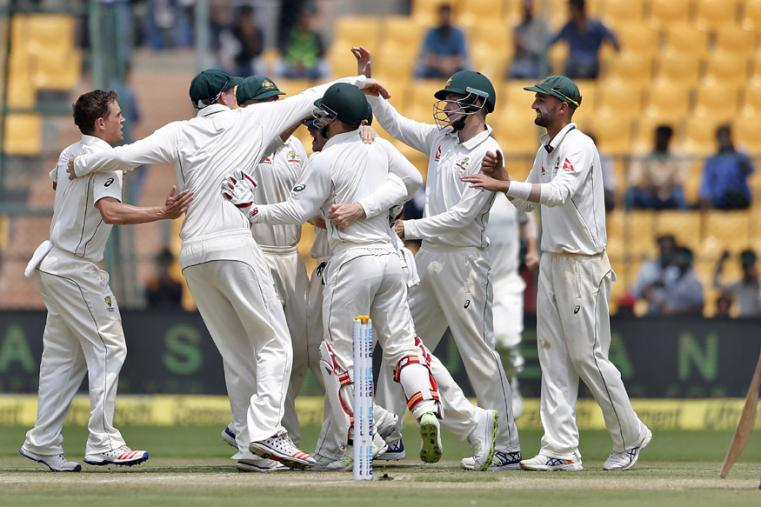 Australian players celebrate the dismissal of India's Lokesh Rahul during the third day of the second Test. (AP Photo)