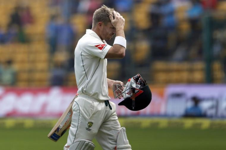 Australia's David Warner leaves the ground after being dismissed during the second day of their second test cricket match against India in Bengaluru. (AP Photo)