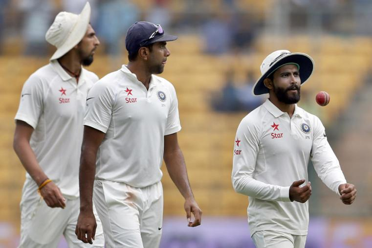 India's Ravindra Jadeja, right, leaves the field with teammates Ishant Sharma, left, and Ravichandran Ashwin at the end of Australia's first innings during the third day of the Bengaluru Test. (AP Photo)