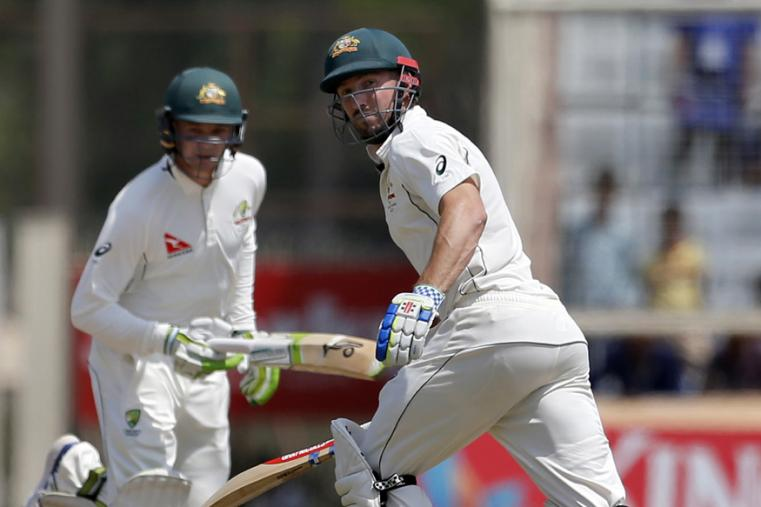 Australia's Shaun Marsh, right, and Peter Handscomb run between the wickets to score runs during the fifth day of the Ranchi Test. (AP Photo)