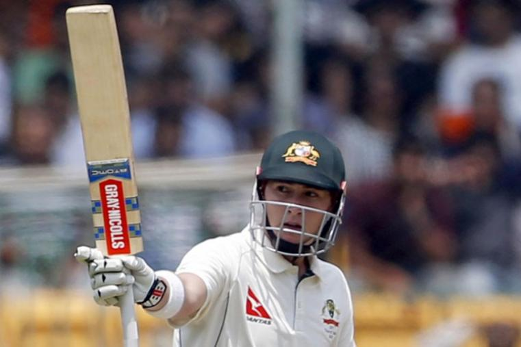 Australia's Matt Renshaw raises his bat to celebrate scoring fifty runs during the second day of the of the Bengaluru Test. (AP Photo)