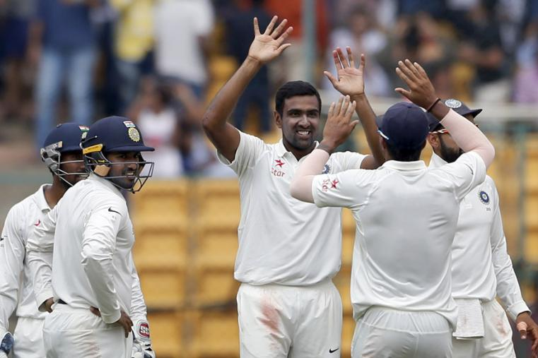 India's Ravichandran Ashwin, facing camera, celebrates the dismissal of Australia's Mitchell Marsh during the fourth day of the Bengaluru Test. (AP Photo)