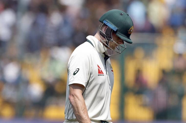 Australia's captain Steven Smith leaves the field after being dismissed during the fourth day of the Bengaluru Test. (AP Photo)