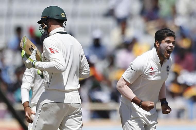 India's Umesh Yadav, right, celebrates the dismissal of Australia's Peter Handscomb, left, during the first day of the Ranchi Test. (AP Photo)
