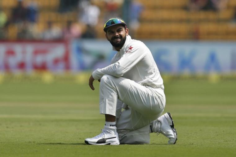 India's captain Virat Kohli reacts after failing to take a catch on the second day of the Bengaluru Test. (AP Photo)