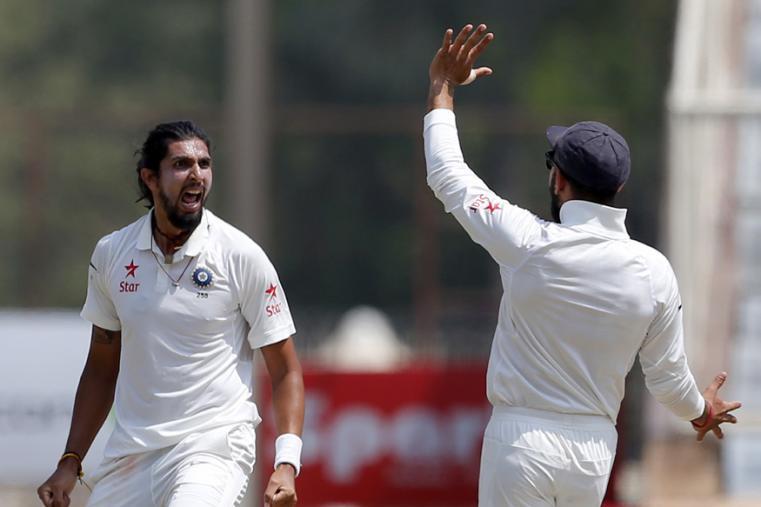 India's Ishant Sharma, left, celebrates with captain Virat Kohli the dismissal of Australia's Matt Renshaw during the fifth day of the Ranchi Test. (AP Photo)