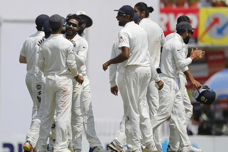 India's Ravindar Jadeja, third left without cap, celebrates the dismissal of Australia's captain Steven Smith during the fifth day of the Ranchi Test. (AP Photo)