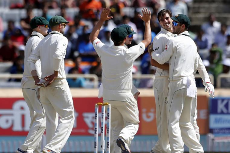 Australia's Pat Cummins, second right, celebrates with teammates the dismissal of India's Ajinkya Rahane during the third day of the Ranchi Test. (AP Photo)
