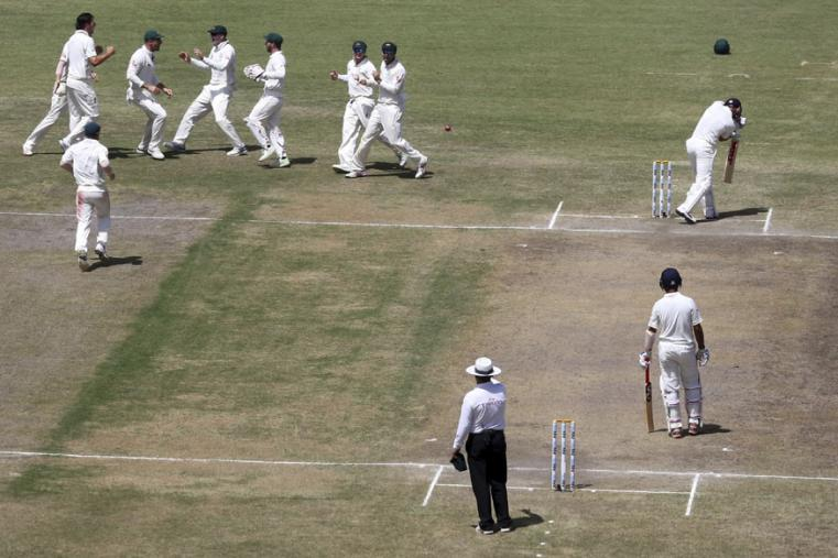 Australian players celebrate the dismissal of India's captain Virat Kohli, top right, during the third day of the Ranchi Test. (AP Photo)