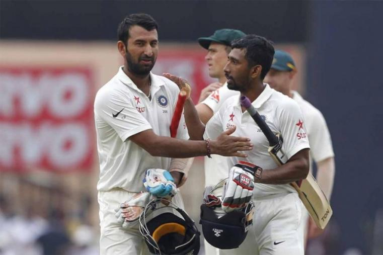 Cheteshwar Pujara scored a double-century and Wriddhiman Saha notched up a ton as the duo produced a partnership of 199 runs to enable India declare their first innings at 603/9 for a lead of 152 runs. (AP Photo)