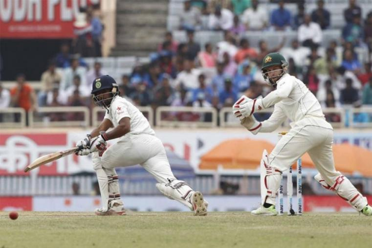 Wriddhiman Saha was also in excellent form at the other end, scoring 117 runs. His third century in the longest format of the game came off 233 deliveries and included eight boundaries and a six. (BCCI Photo)