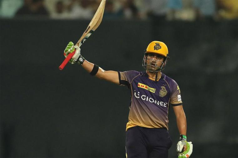 KKR skipper Gautam Gambhir raises hi bat after completing his half-century against KXIP. (BCCI Photo)