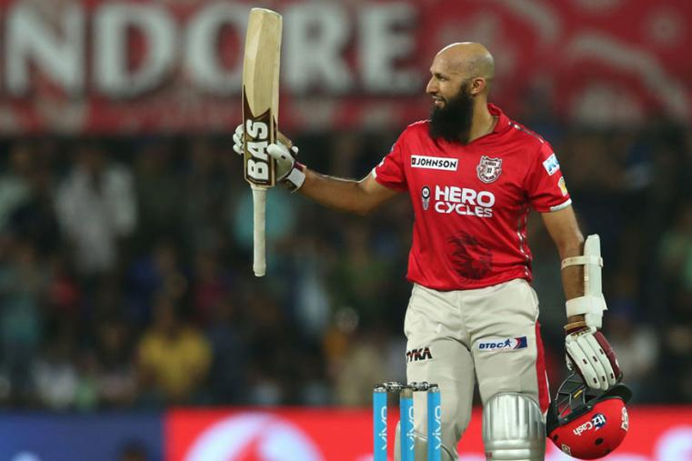 KXIP opener Hashim Amla celebrates after reaching his maiden T20 century on Thursday. (BCCI Photo)