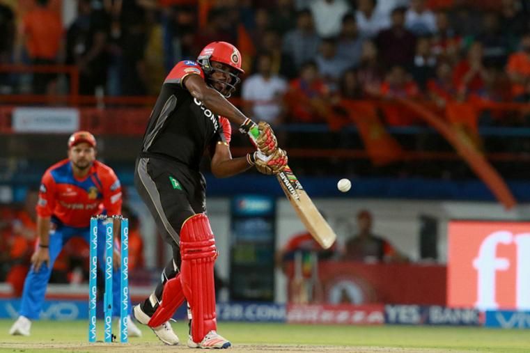 RCB batsman Chris Gayle hits a six during his knock of 77 on Tuesday. (BCCI Photo)