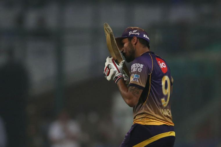 KKR batsman Manish Pandey kisses his bat after taking Kolkata home by 4 wickets against Delhi at the Kotla on Monday. (BCCI Photo)