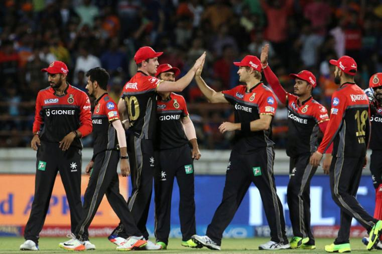 RCB players celebrate the fall of Brendom McCullum's wicket on Tuesday. (BCCI Photo)