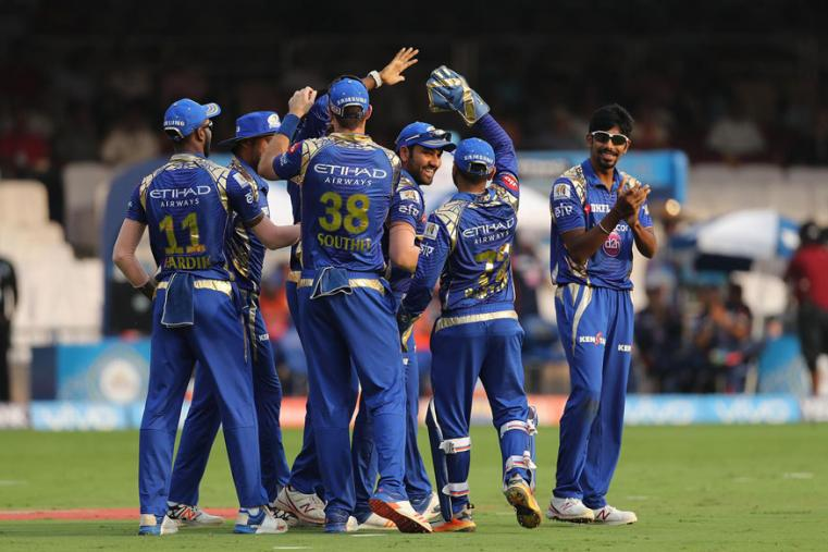 Rohit Sharma is surrounded by teammates after the skipper took a brilliant catch against RCB. (BCCI Photo)