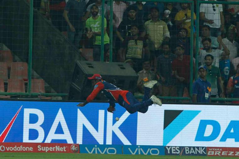 DD fielder Sanju Samson jumps over the rope at long on and flicks the ball into play before falling over. (BCCI Photo)