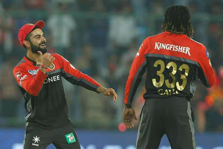 Virat Kohli celebrates with Chris Gayle after the latter picks a wicket against DD. (BCCI)