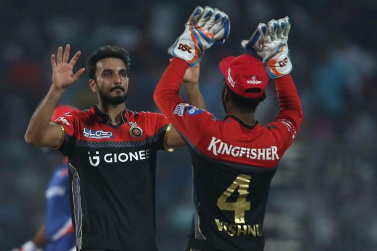 Harshal Patel celebrates taking a wicket against DD. (BCCI)