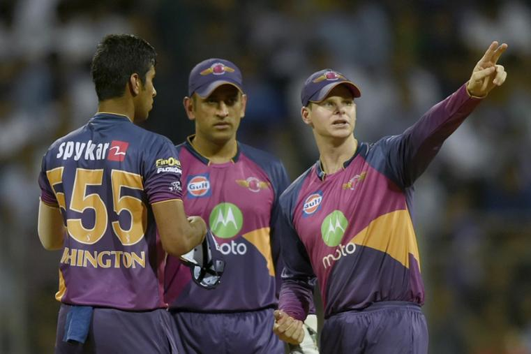 Rising Pune Supergiant cricketer Washington Sundar listens to Steven Smith (R) as Mahendra Singh Dhoni looks on during the Qualifier 1 match (BCCI Photo)