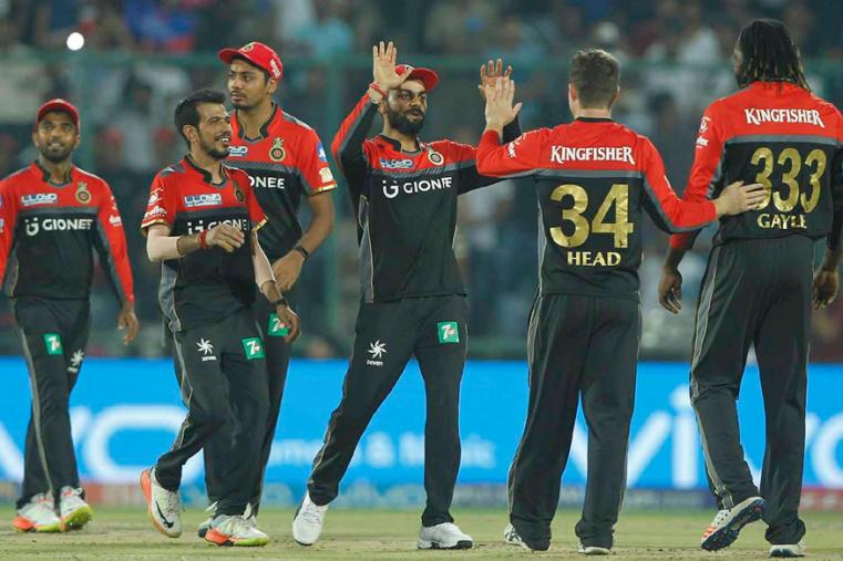 RCB players celebrate fall of a wicket against DD. (BCCI)