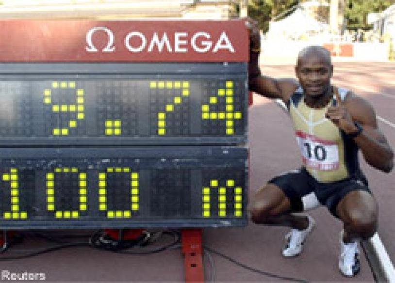 Powell blazes to new 100 metres world record