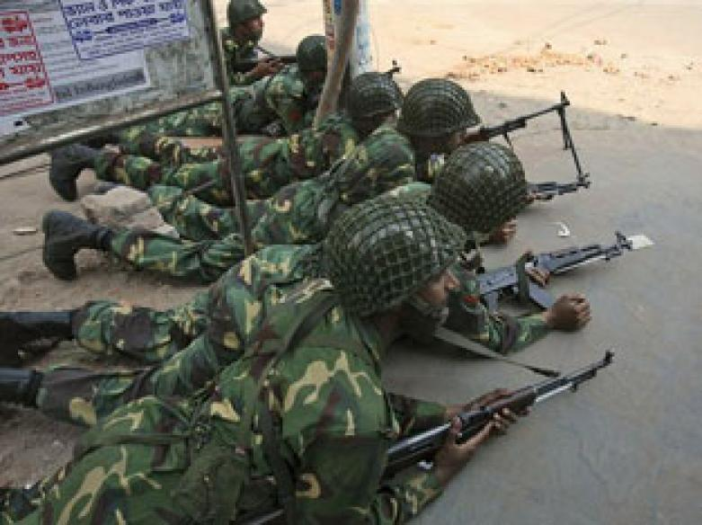 Rebel Bangladeshi soldiers begin laying down weapons