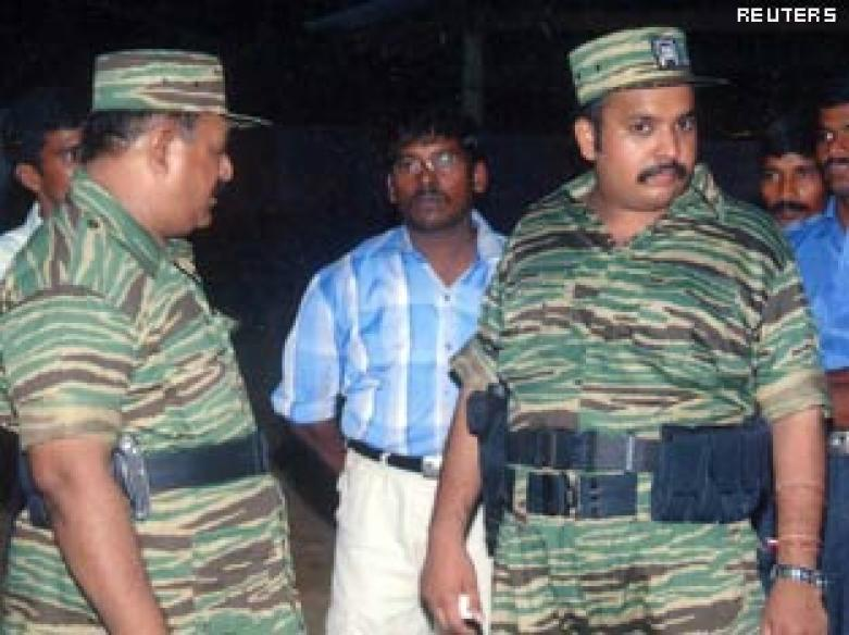 Prabhakaran, son killed while fleeing | <a href='http://ibnlive.in.com/news/leader-killer-the-man-who-was-prabhakaran/92880-2-6.html'>The man who was Prabhakaran</a>