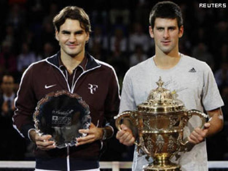 Federer beaten by Djokovic in home final