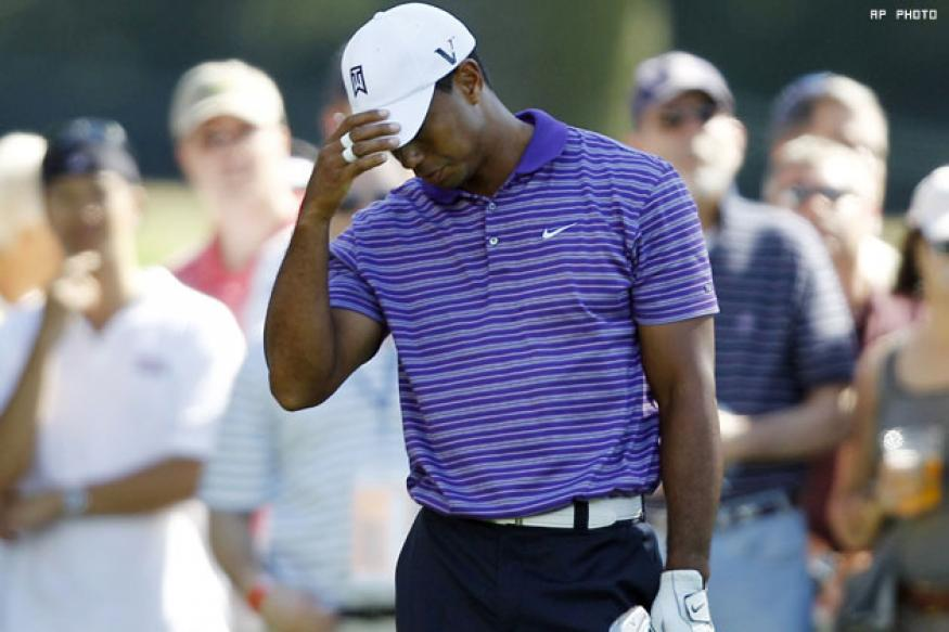 Woods recovers after car park fiasco
