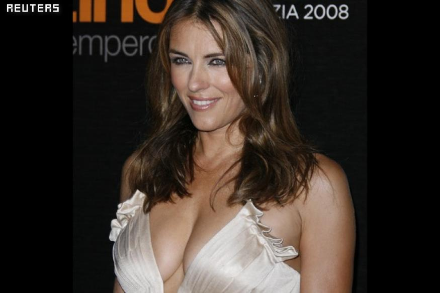 Shane Warne bowls out wife for Liz Hurley?