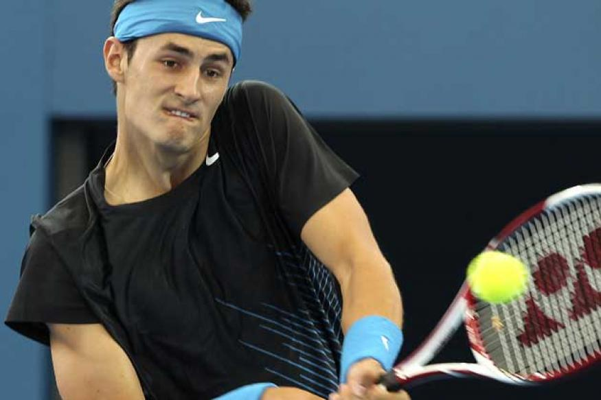 Tomic beats Monfils to reach Kooyong final