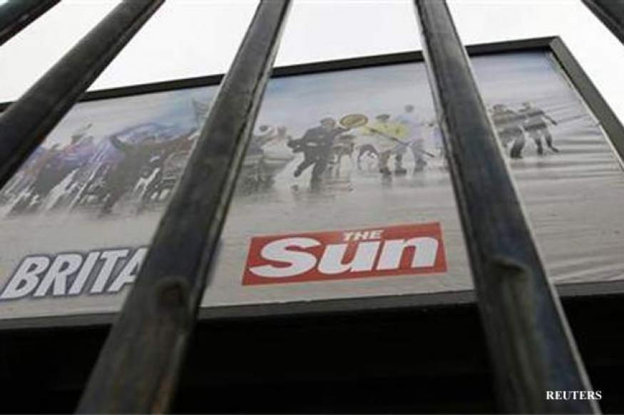 UK police arrest 5 at Murdoch's Sun newspaper