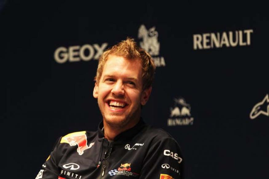 Vettel predicts tight fight for F1 title