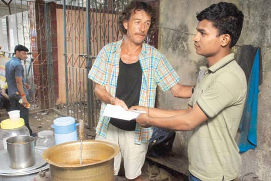 Marathon winner gives prize money to tea stall worker