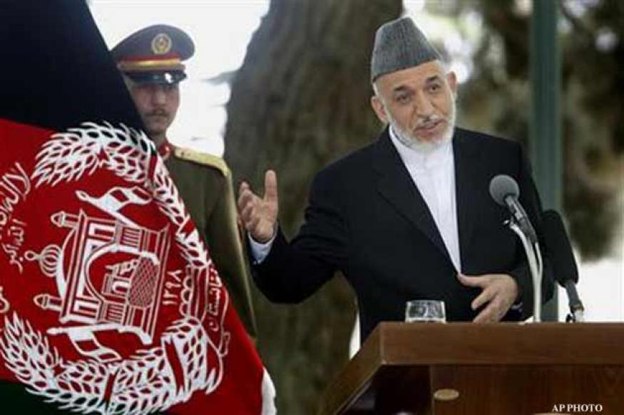 Afghan President condemns US troop photos