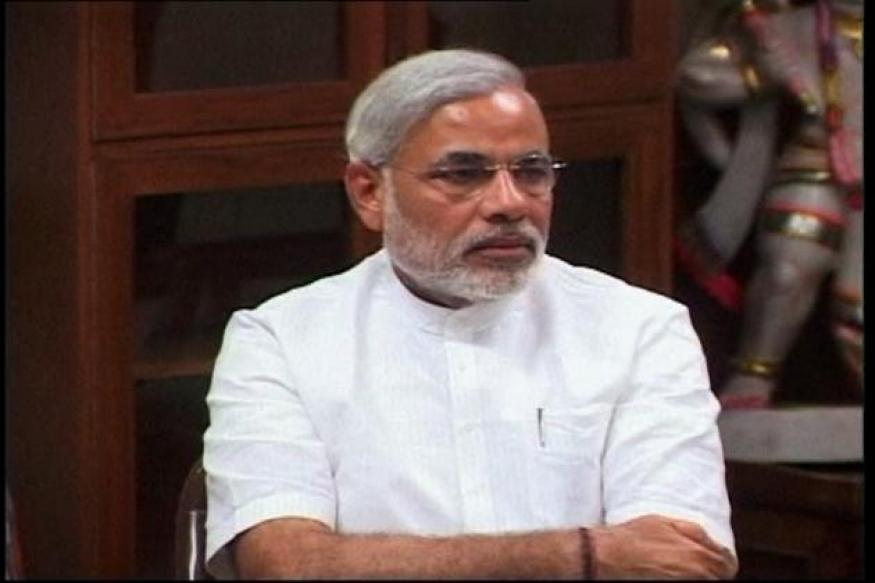Gujarat moving ahead despite all odds: Modi