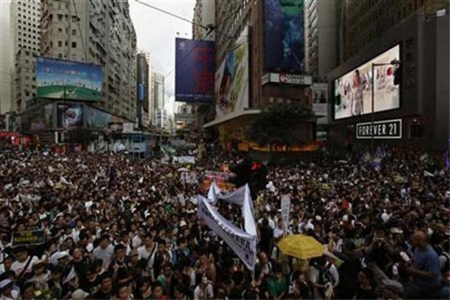 Crowds protest in Hong Kong as Hu anoints leader