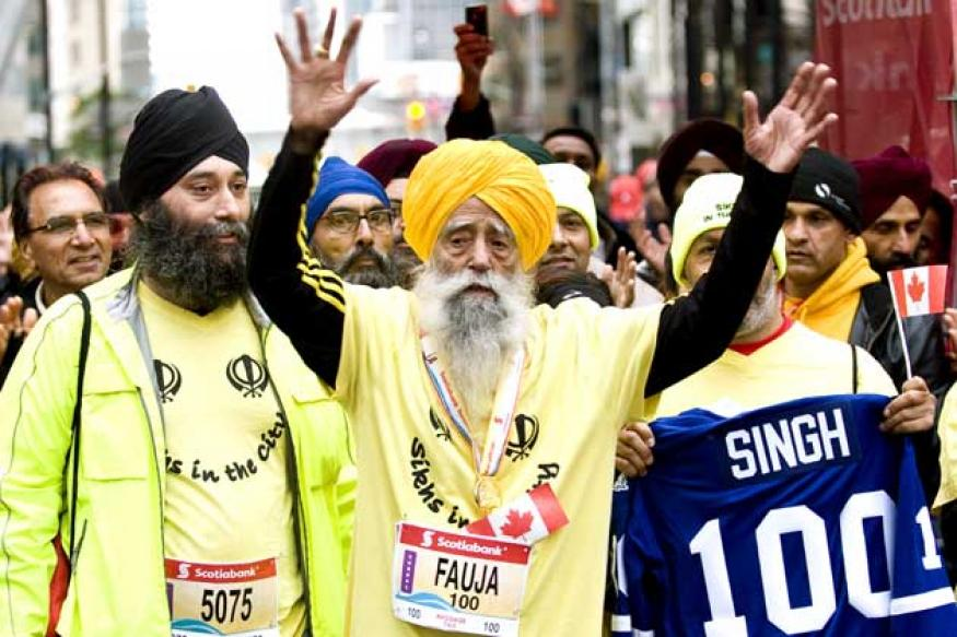 Fauja Singh, 101, dazzles in Olympic Torch relay