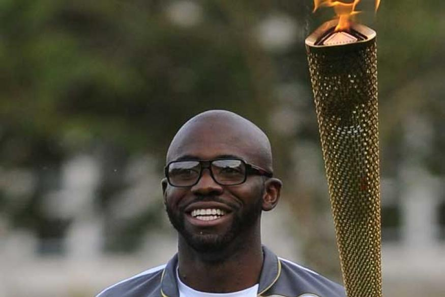 Fabrice Muamba carries Olympic torch