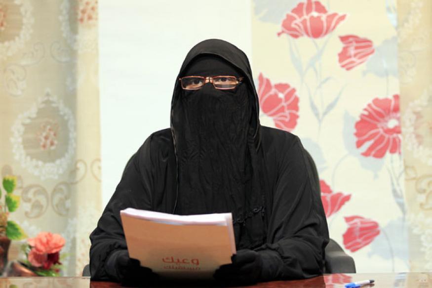 Egypt's veiled news anchor stirs debate