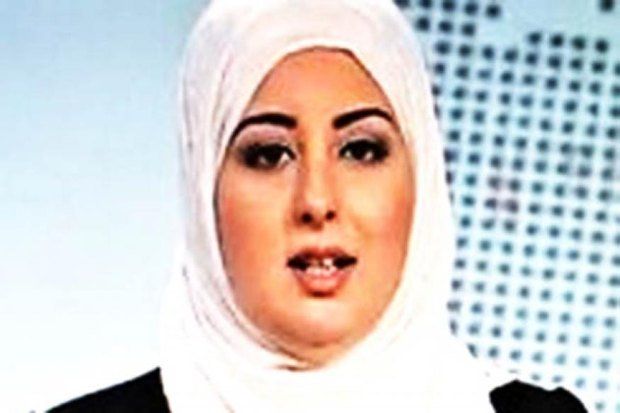 A first: Veiled woman reads news on Egypt state TV