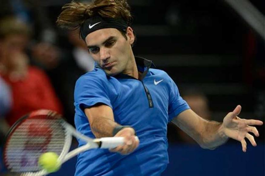 Federer wins in 1st round at Swiss Indoors