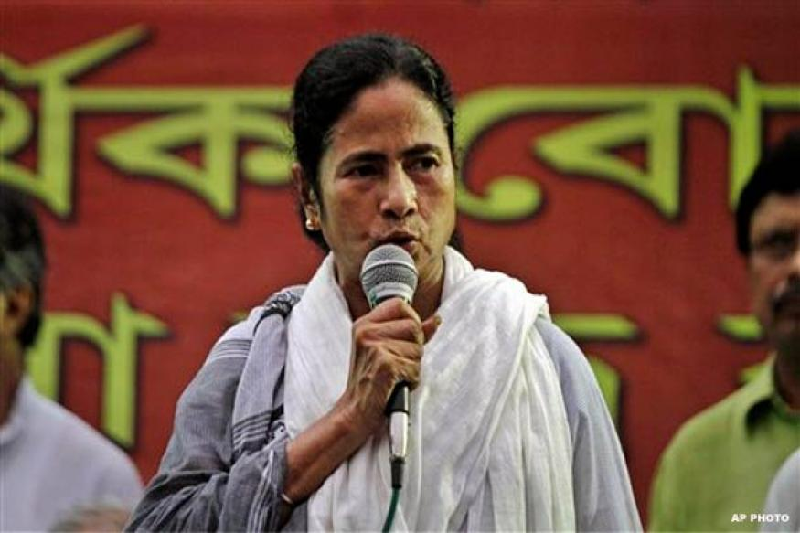 No industrialisation by selling the country : Mamata