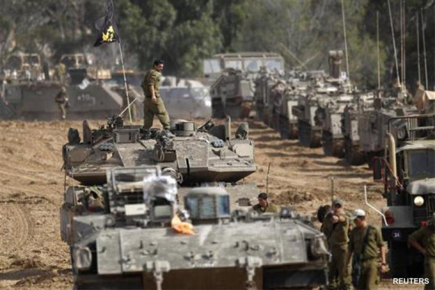 Israel calls in reservists after rockets hit cities